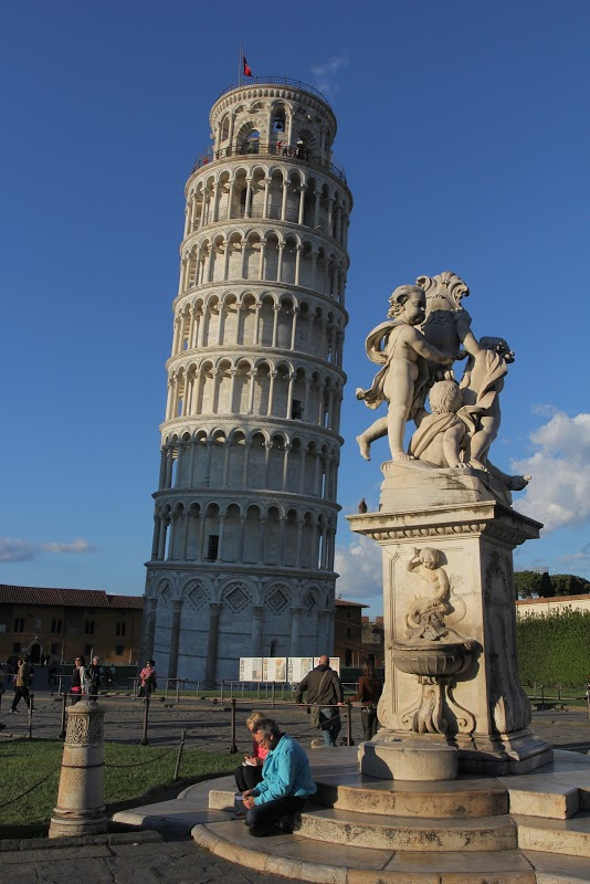Cupid statue against the Leaning Tower of Pisa